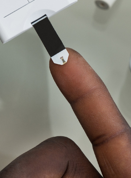a close up of a finger during a blood test